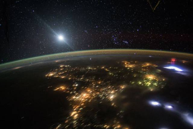"Astronaut Captures a Rare ""Red Sprite"" Sighting While Watching a Thunderstorm from Space"