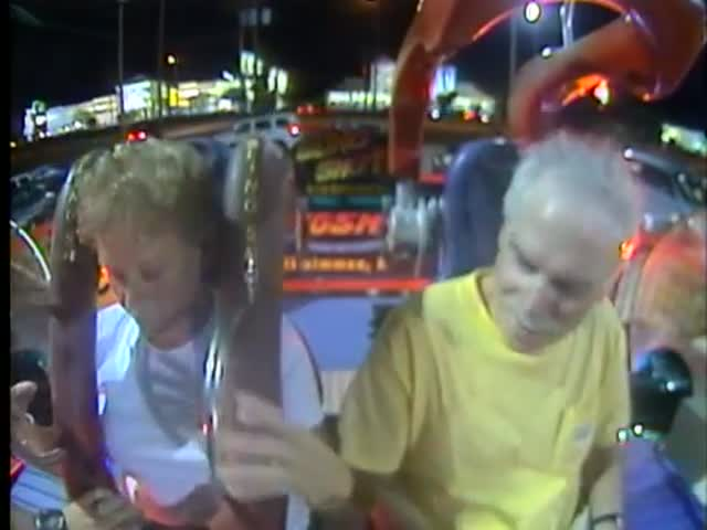 Brave Elderly Couple Experiences the Terrifying Thrill of the Slingshot Ride