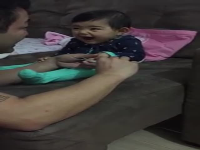 Cute Baby Girl Finds Cutting Her Nails Very Funny