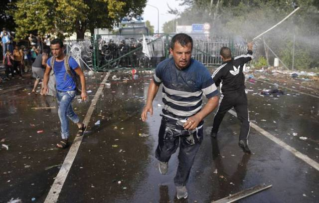 Hungarian Police Fight Migrants with Tear Gas and Water Cannons
