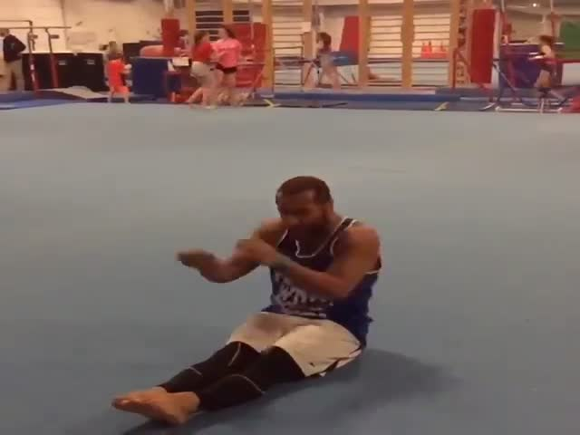 Amazingly Skilled Gymnast Performs Multiple Backflips Starting from a Sitting Position