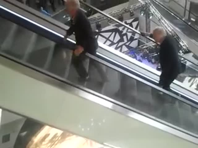 Two Old Dudes Travel the Wrong Way Up the Escalator and the Result Is Hilarious