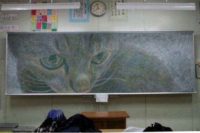 A Skilled Artist Uses His Classroom Chalkboard as a Constant Canvas