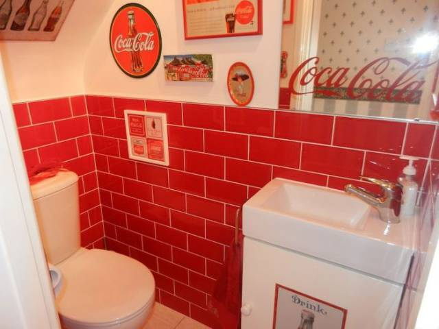 Woman Turns Her House into a Shrine for Coca-Cola