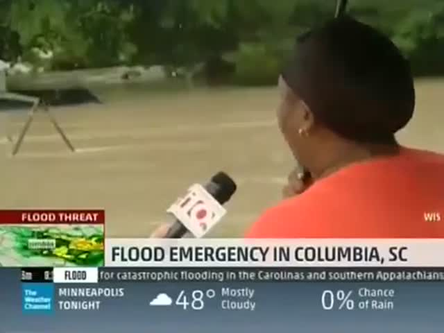 This News Interview During a Flood Is the Funniest Thing You Will Watch Today