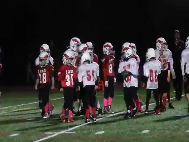 Adorable Pee Wee Football Team Break Out Their Dance Moves During the Game