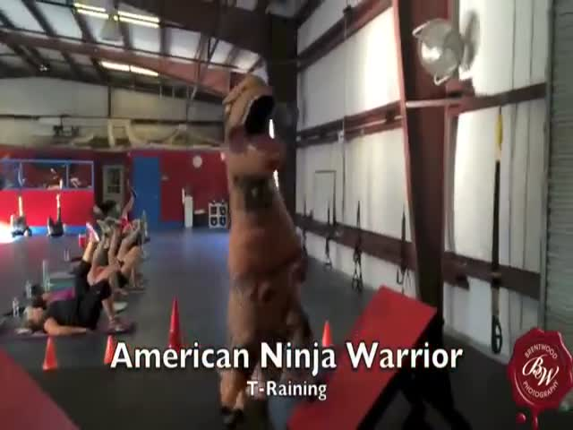 This American Ninja Training Course Is Tough Going for This Poor T-Rex Dinosaur