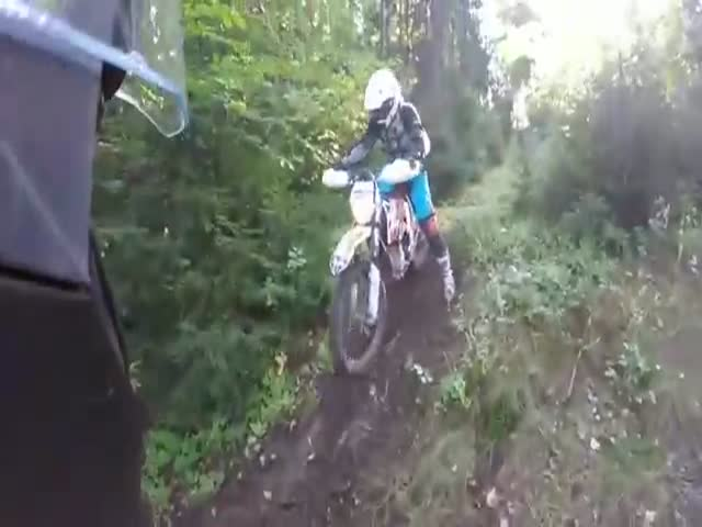 Girl Gets Stuck in the Mud on Her Motorbike