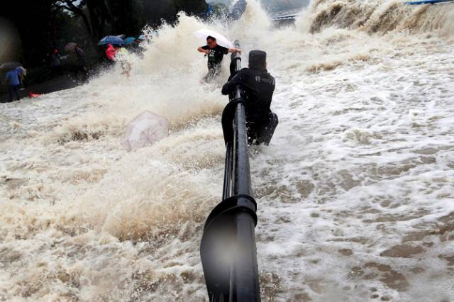 Chinese Locals Dodge Death By Getting Scarily Close to a Tidal Wave for Fun