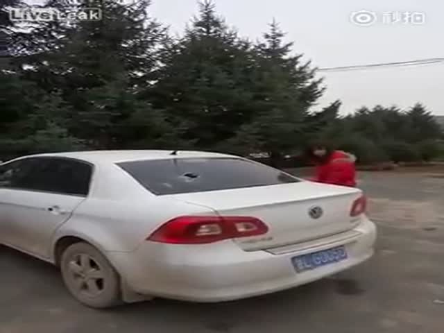 Chinese Wife Takes Out Her Anger on Her Cheating Husband's Car