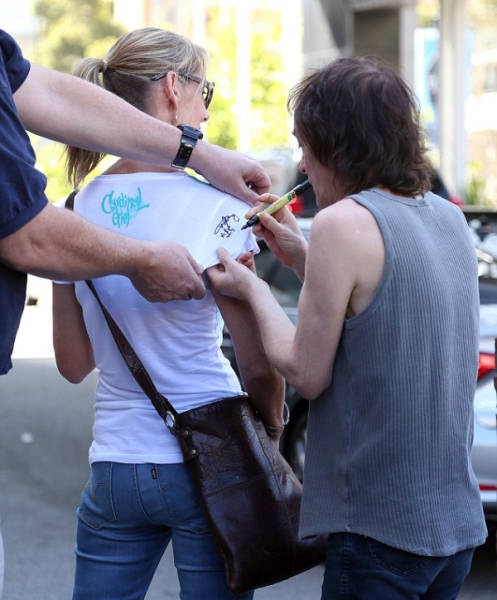 Angus Young Still Makes Time for Fans at 60 Years Old