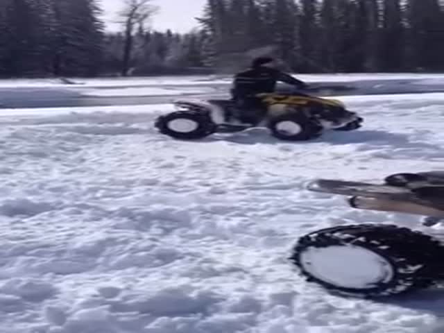 An ATV Rider Doing Donuts Takes a Tumble After Losing Control