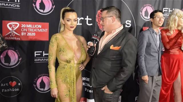 Busty Model Shows Off Her Gorgeous Assets in a Beautiful Barely-There Dress