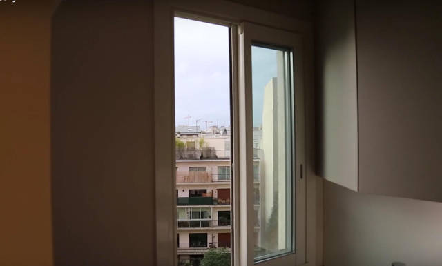 This Man Has a Unique View of the Eiffel Tower Straight from the Comfort of His Own Bed