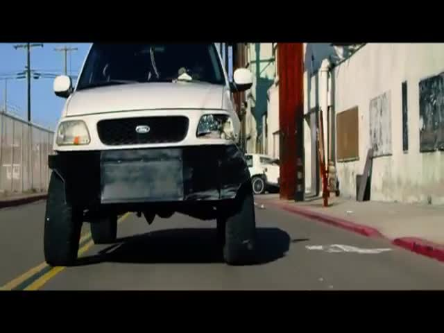 Rival Movie Execs Battle It Out to See Who Does It Best in Truck Flipper vs. Bus Puncher