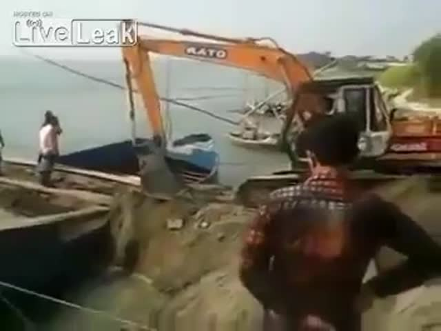 This Extreme Excavator Makes Loading a Boat Look Very Hard Core
