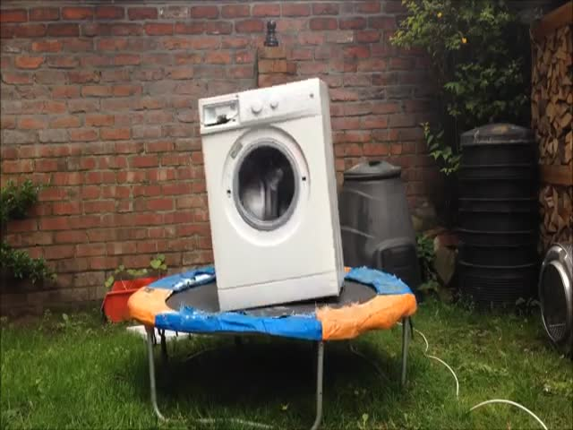 A Brick In A Washing Machine On A Trampoline