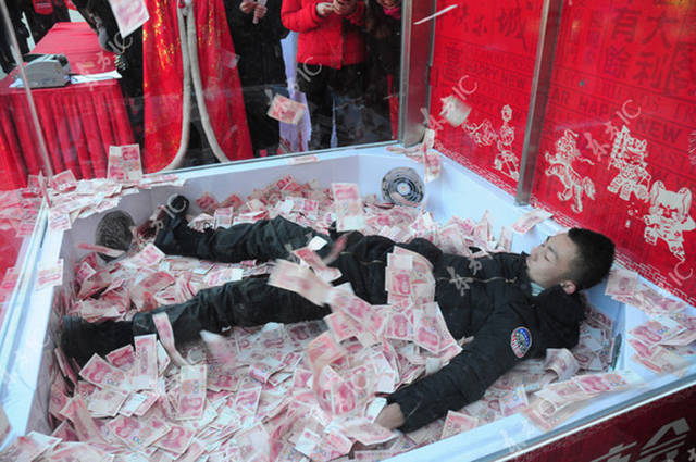 There Is Nothing Quite as Awesome as Swimming in a Pool of Money