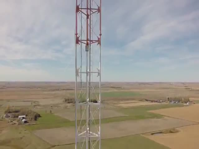 TV Tower Repairman In An Astonishing Footage Made By A Drone