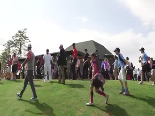 At An Inaugural Opening Of A Golf Course For Kids By Tiger Woods, The Kid Makes A Perfect Shot