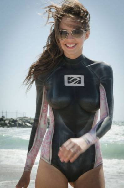 Sexy Surfer Girls Wearing Body Paint Instead Of A Wetsuit