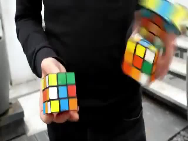 Man Solves 3 Rubik's Cubes. At The Same Time. While Juggling!