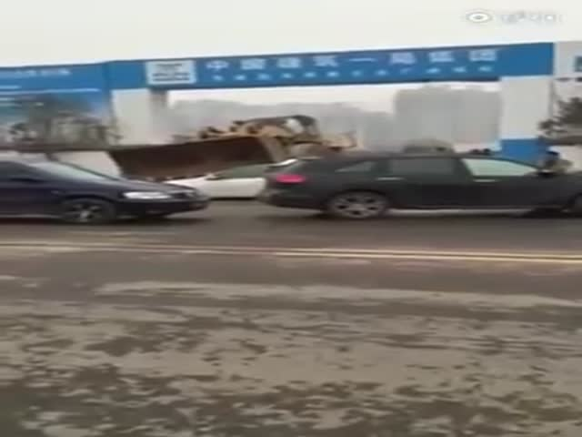 Front Loader Clears The Way From Cars That Blocked Construction Site Entrance