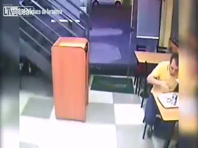 Guy Doesn't Care If There's An Armed Robbery At A Restaurant As Long He Has His Sandwich To Eat