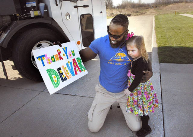 Little Girl Offers Her Birthday Cupcake To Her Favorite Garbage Man