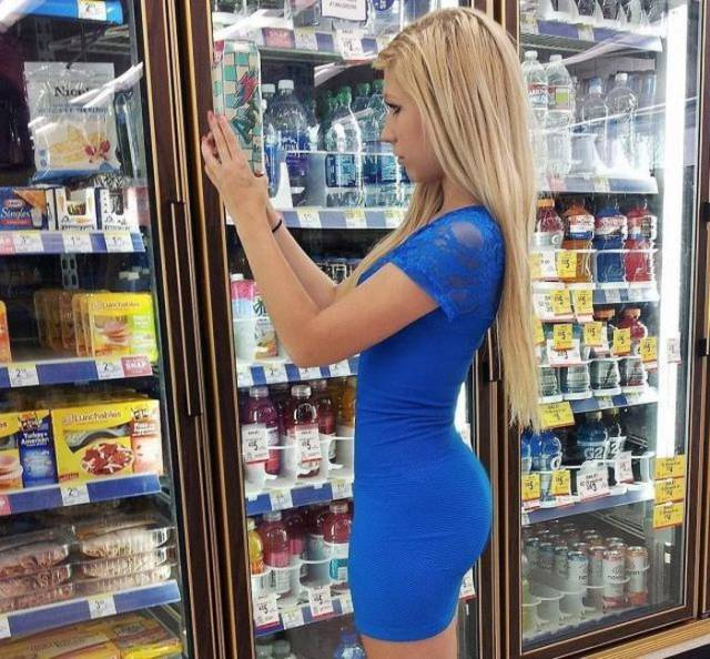 Sexy woman grocery shopping