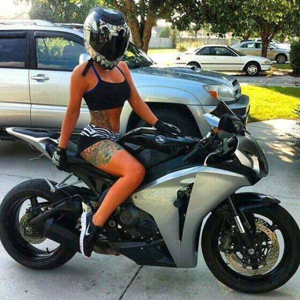 There's Something Incredibly Hot About A Gal And A Bike