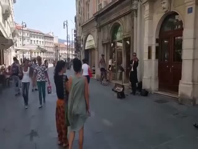 Dad Encourages His Daughter To Dance To The Music Of The Street Musician