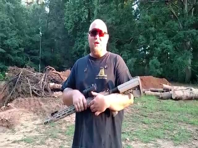 Man Demonstrates The Recoil Of Ar-15 By Placing The Butt Of The Gun Against His Nose