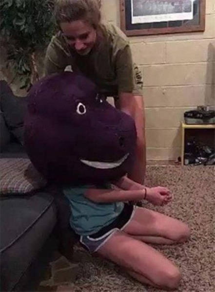 Girl Gets Stuck In The Head Of Barney The Purple Dinosaur