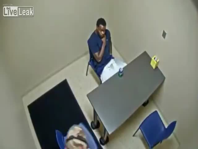Murder Suspect Tries To Steal A Gun From A Cop In An Interview Room