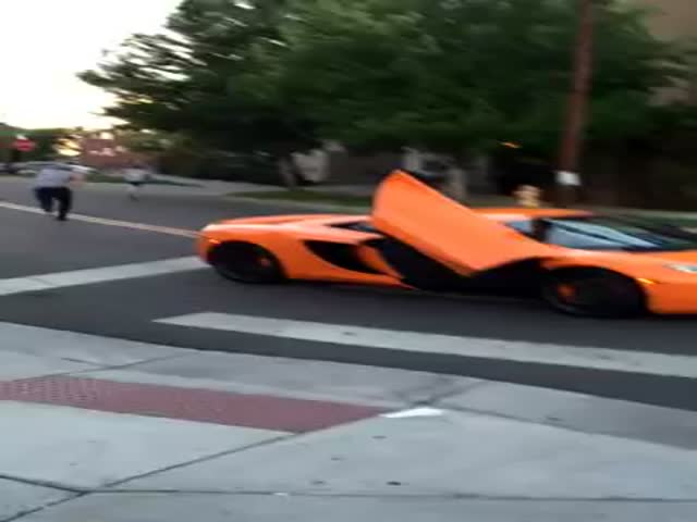 Guy Runs A Stop Sign And Gets His $250,000 Car's Windshield Smashed By Kid On A Skateboard