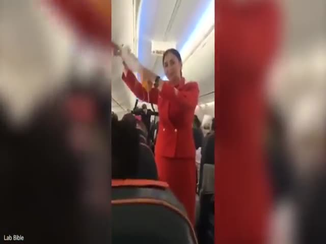 Football Fans Make It Hard For Flight Attendant To Do The Safety Briefing