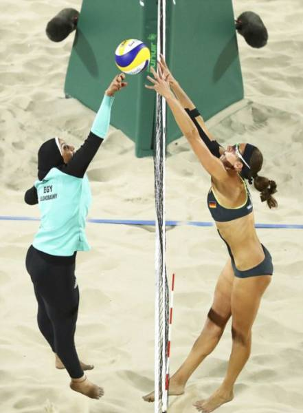 Cultural Differences Are Visible With The Naked Eye During A Beach Volleyball At The Olympics