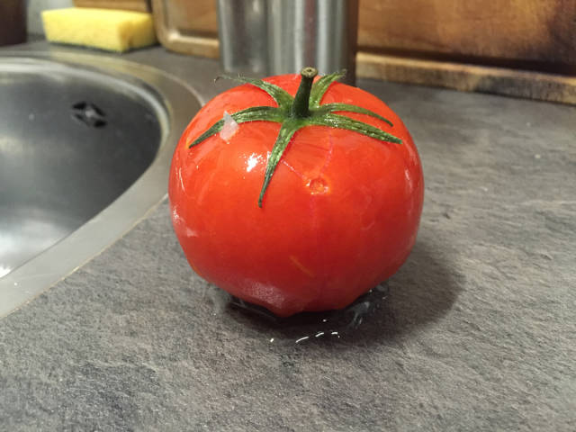 This Is What Happens To A Frozen Tomato After It Was Taken Out Of A Freezer