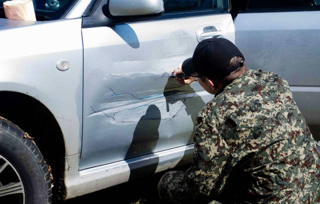 Russian Guy Comes Up With A Creative Way To Cover His Car Bump