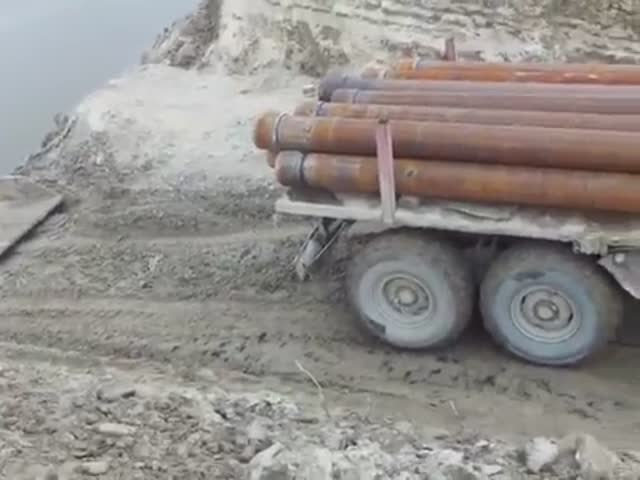 A Truck Transporting Pipes Drowned During River Crossing In Russia