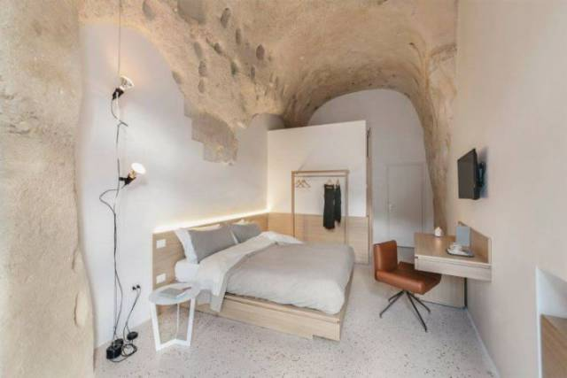There Is A Jaw-Dropping Hotel Inside This Cave In Italy