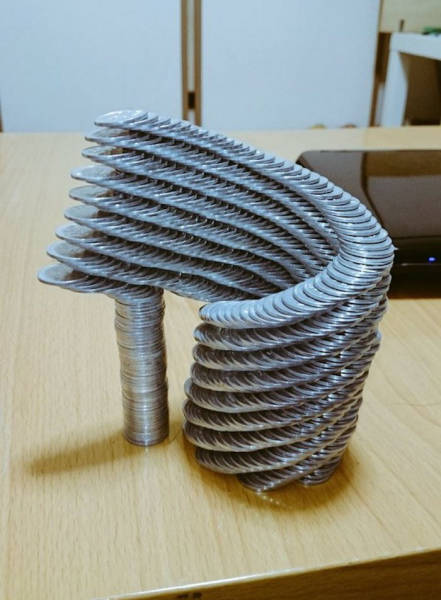 This Japanese Guy Took Coin Stacking To A Whole New Level