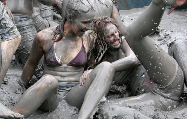 Girls Having Fun At The Korean Mud Festival