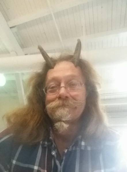 Pagan Priest Wears Horns For His Driving License Photo
